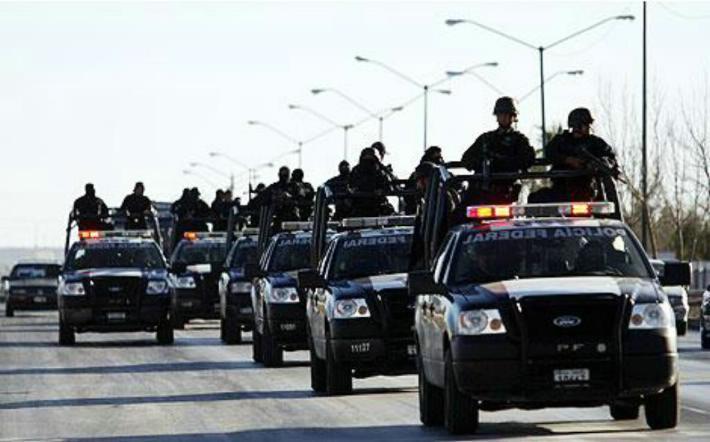 Investigan a policías federales que habrían participado en bloqueo carretero - Foto de archivo.