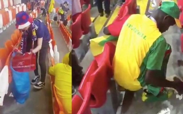 #Video Aficionados de Senegal y Japón limpian gradas tras partido - Captura de Pantalla