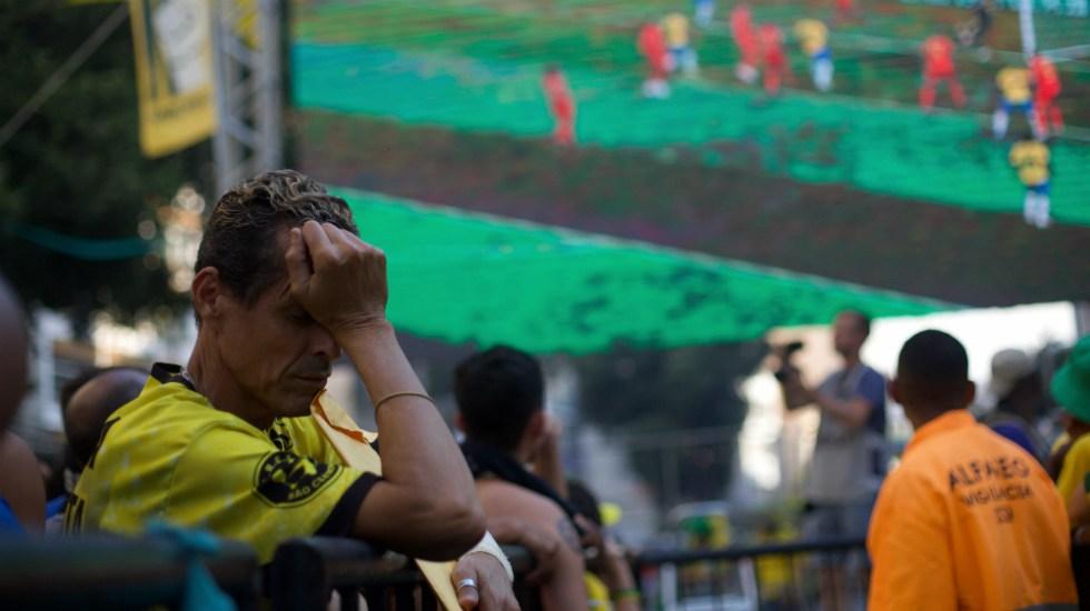 Decepción y enojo en Brasil por prematura eliminación del Mundial - Foto de Mauro Pimentel / AFP