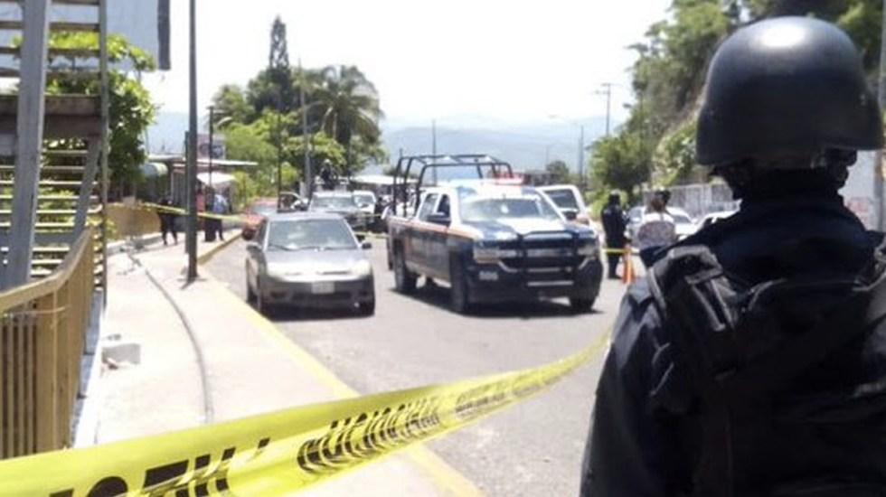 Hallan dos cadáveres en automóvil en Acapulco - Foto de Internet