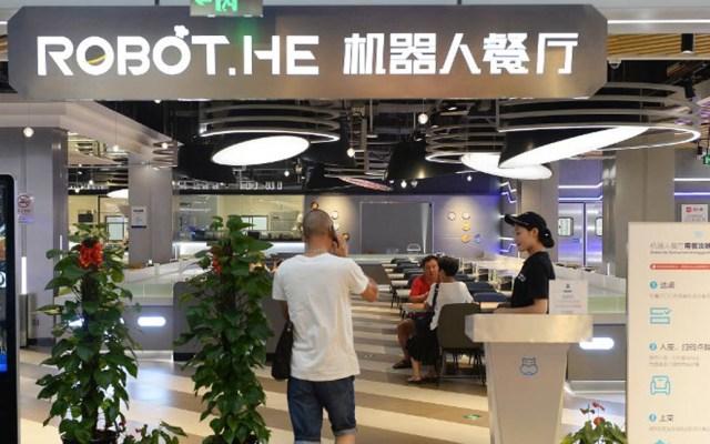 Restaurante reemplaza a meseros por robots en China - Foto de AFP