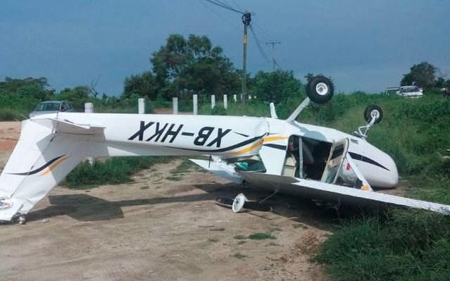 Avión pequeño se desploma en carretera Acapulco-Pinotepa Nacional - Foto Especial