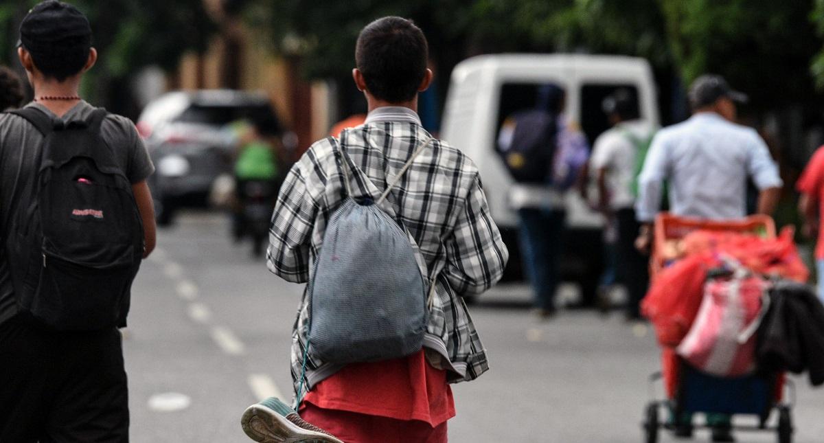 Migrante miembro de caravana hondureña rumbo a EE.UU. Foto de AFP / Orlando Sierra