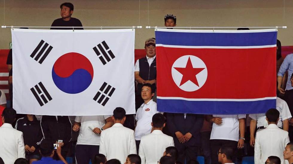 Coreas envían solicitud para albergar Juegos de 2032 - Banderas de Corea del Norte y Corea del Sur. Foto de Internet