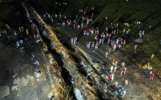 Trasladan primeros cuerpos para practicar exámenes forenses tras explosión - Foto de AFP