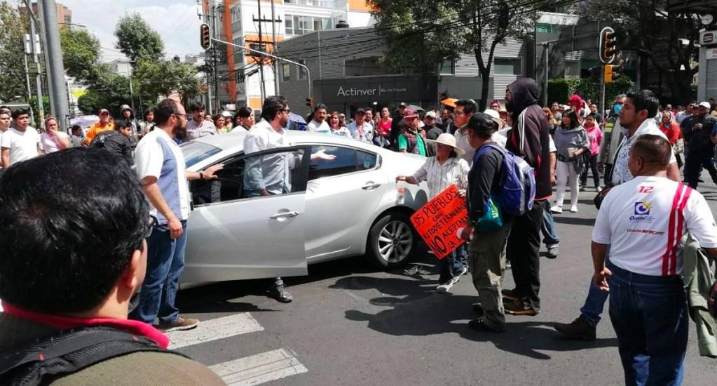 #Video Conductor se enfrenta a manifestantes en Insurgentes Sur. Noticias en tiempo real