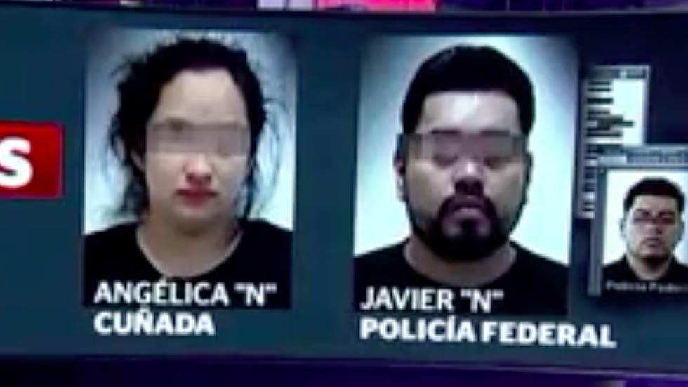 Cuñada del Marro y su esposo tras ser detenidos. Foto de Noticieros Televisa