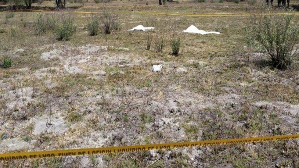 Cadáveres de madre e hija en lote baldío de Acolman. Foto Especial / El Universal