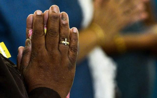 Ataque en iglesia católica de Burkina Faso deja seis muertos - Fiel católico. Foto de AFP