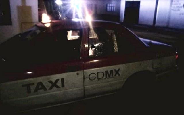 Asesinan a pareja dentro de taxi en Nezahualcóyotl - Taxi donde fue hallada la pareja sin vida en Nezahualcóyotl. Foto Especial / LDD
