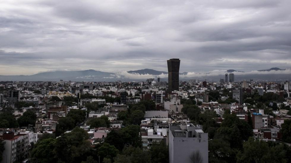 Activan Alerta Amarilla por lluvia con granizo en 7 alcaldías capitalinas - Cielo medio nublado con probabilidad de lluvia en la CDMX. Foto de Notimex