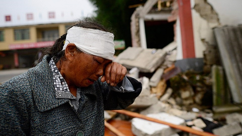 Mujer herida por sismo en China. Foto de AFP / Getty Images