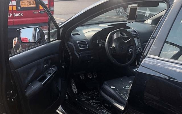 Bombero rescata a niño del interior de un coche en Queens - Foto de FDNY