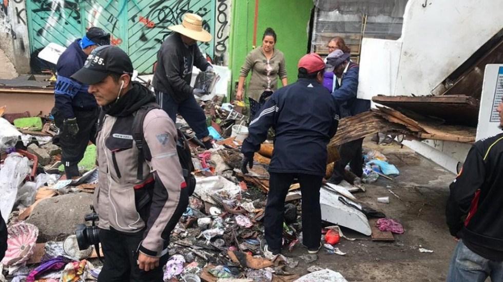 Continúa limpieza en Nicolás Romero tras inundación por desbordamiento de río - Limpieza de casas y calles inundadas en Nicolás Romero. Foto de @GobiernoNicolas
