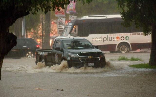 Huracán Lorena causará lluvias torrenciales en Sinaloa - Afectaciones del ciclón Lorena en la ciudad de Culiacán, Sinaloa. Foto de EFE