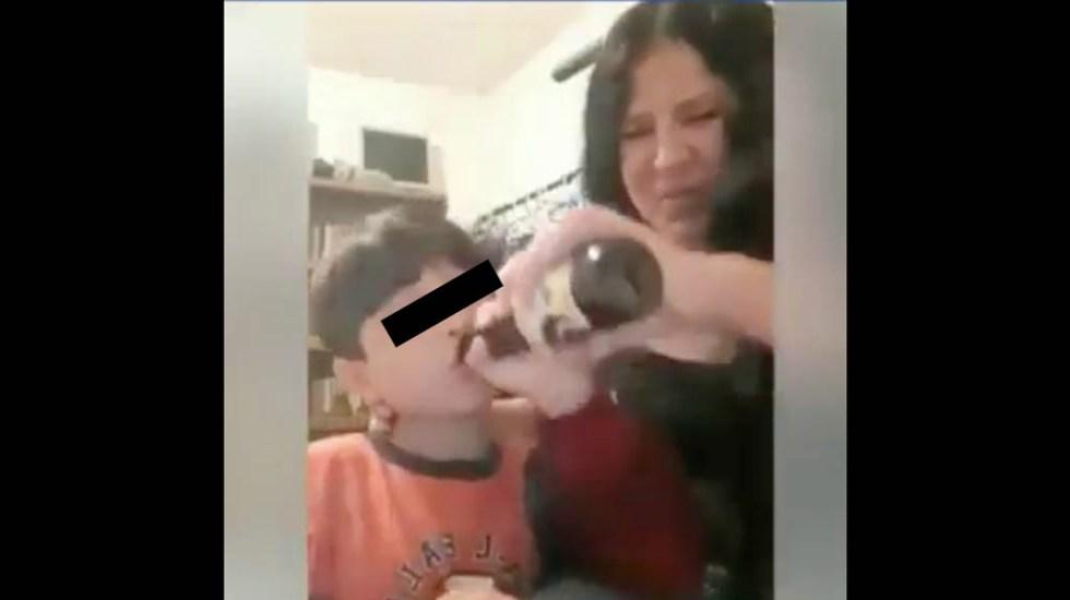 DIF busca a mujer que aparece en video dando cerveza y cigarro a su hijo - Mujer cerveza hijo alcohol