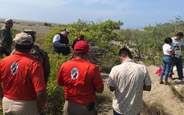 Naufragio de migrantes en Chiapas deja un camerunés muerto - Búsqueda de migrante camerunés que cayó al mar en Puerto Arista. Foto de @FGEChiapas