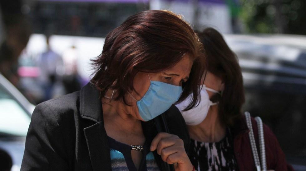 Jalisco confirma cinco casos positivos por COVID-19 - Mujeres con cubrebocas para prevenir el coronavirus. Foto de Notimex