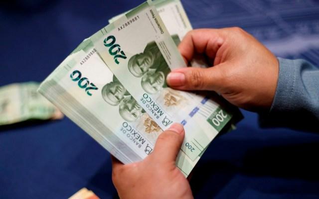 Peso mexicano cierra semana en rojo con miras a mínimos históricos - Foto de EFE