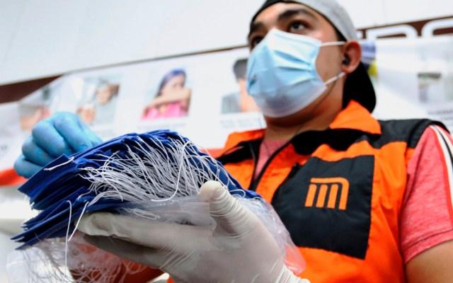 Publican protocolos sanitarios para reinicio de actividades en México - mascarillas cubrebocas covid19 coronavirus Metro