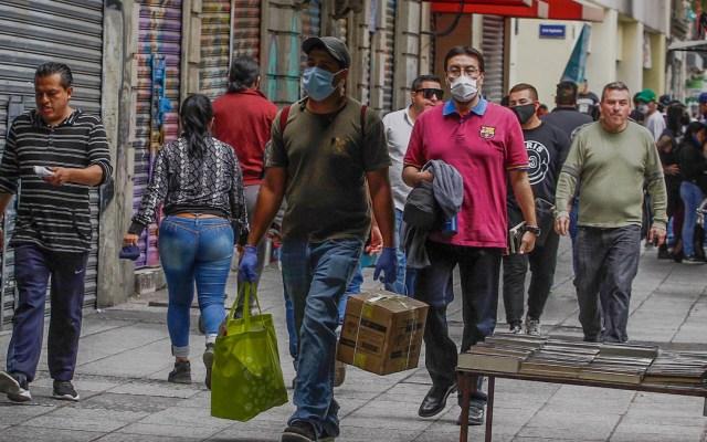 México supera los 720 mil casos de COVID-19 y se acerca a las 76 mil muertes - covid-19 coronavirus México Ciudad cubrebocas calle