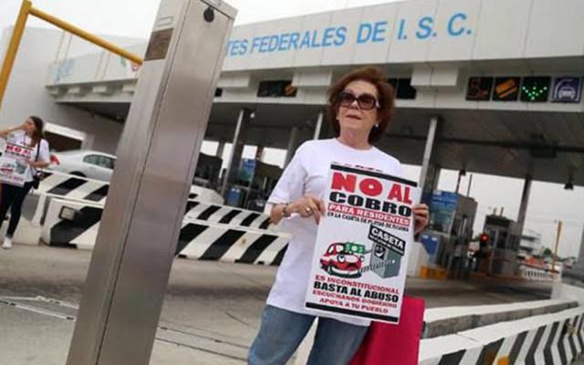 Amenazan con tomar la caseta Playas de Tijuana contra cobro de peaje - Manifestación contra el cobro de peaje en la caseta de Playas de Tijuana. Foto de @EnLinea_BC