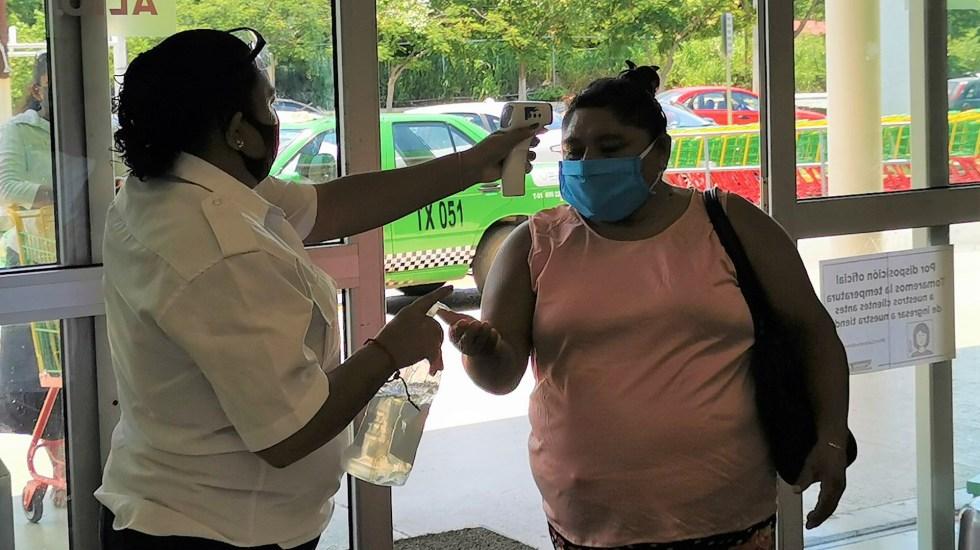 Campeche, el primer estado en semáforo verde ante COVID-19 - Mujer en filtro sanitario de Campeche. Foto de Salud Campeche