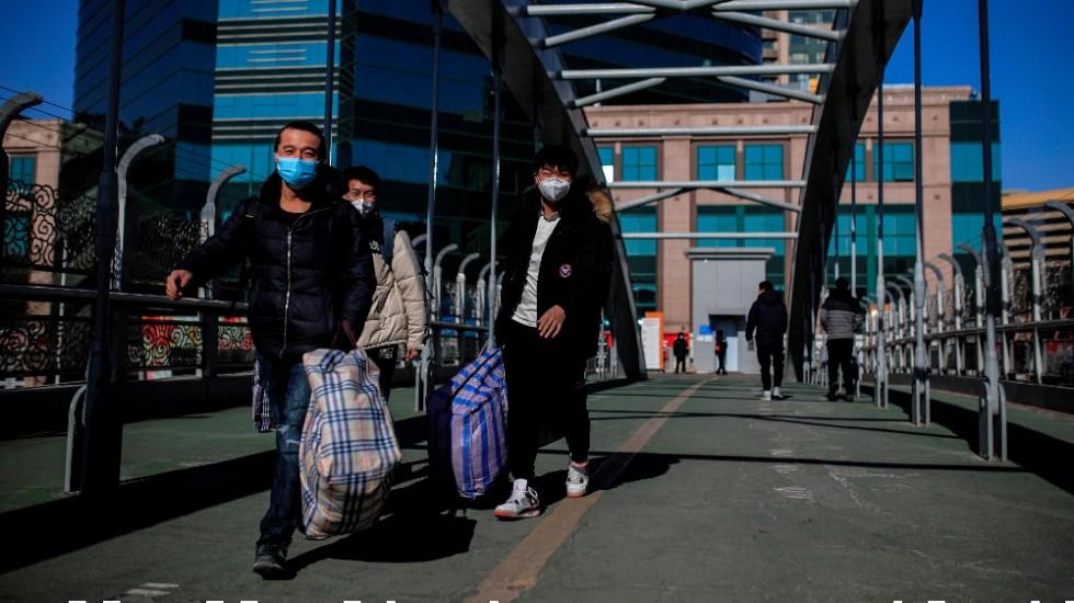 Millones de chinos viajan ante otro Año Nuevo marcado por el temor al COVID-19 - Foto de EFE