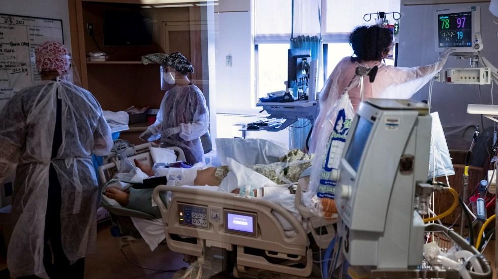 OMS registra la cifra más baja de casos diarios de COVID-19 en cuatro meses - Estados Unidos COVID-19 coronavirus pandemia epidemia