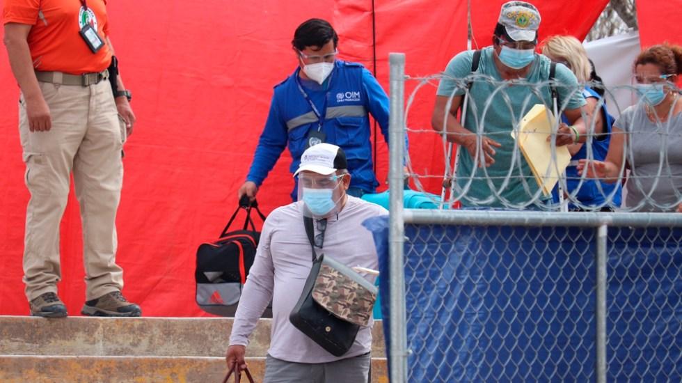 Migrantes usan documentos falsificados de agencia de la ONU para justificar paso por México, denuncia INM - Foto de EFE