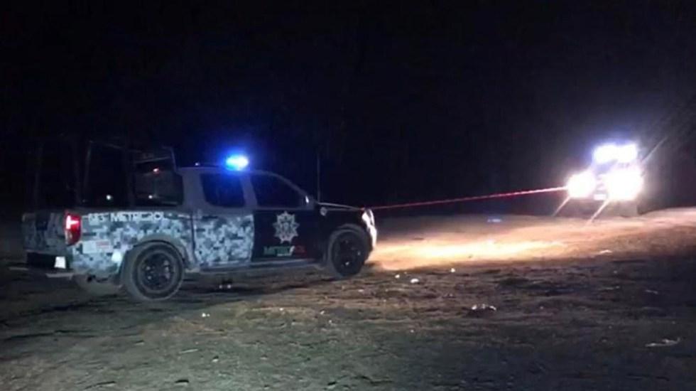 Ejecutan en Zacatecas a cinco personas al interior de dos vehículos - Patrulla en escena del crimen de cinco personas en Zacatecas. Foto de Milenio
