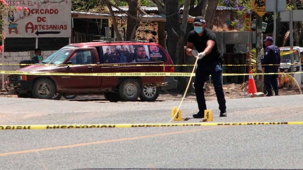 Suman 86 mil 956 homicidios dolosos en lo que va del sexenio - Acordonamiento de escena del crimen en Oaxaca. Foto de EFE