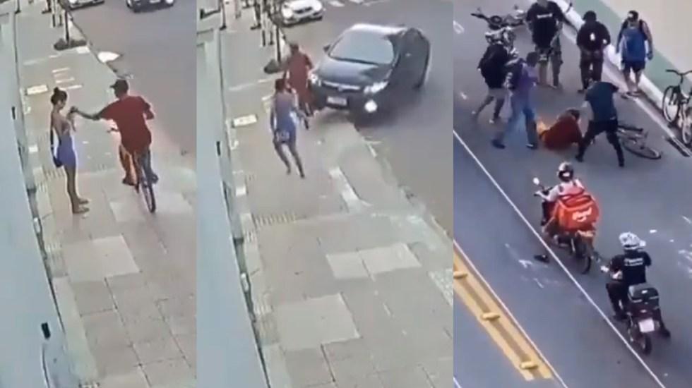 #Video Ciclista roba celular a joven; novio lo atropella y persigue para golpearlo - Asalto a joven en Brasil. Captura de pantalla
