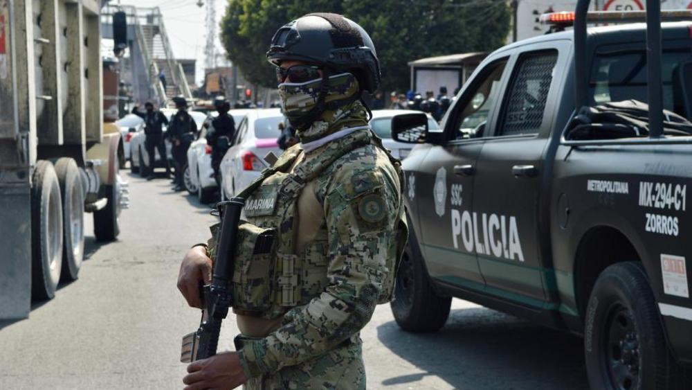 Tras cateos, aseguran en CDMX 32 kilos de cocaína y ocho millones de pesos - Foto de @OHarfuch