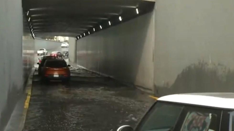 Continúan encharcamientos en CDMX tras fuertes lluvias del miércoles - Encharcamientos Inundaciones bajo puente Ciudad de México