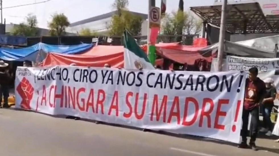 Protestan integrantes del Frente Nacional Obradorista ante el INE - Protestan frente al INE. Foto tomada de video
