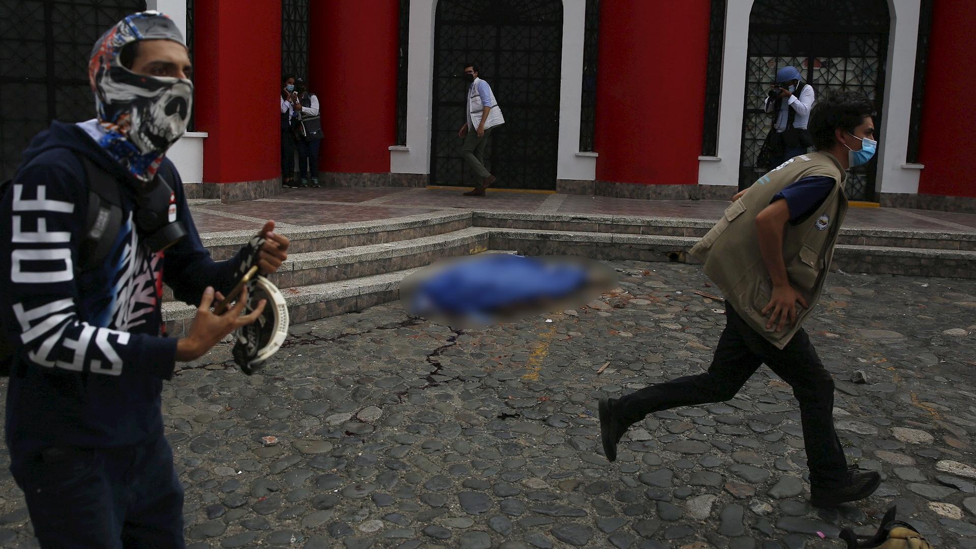 Cali colombia muerto protesta disparos ataque