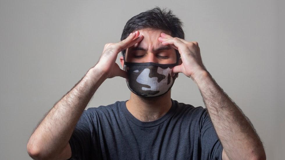 Síntomas neurológicos en COVID-19 multiplican por seis el riesgo de muerte - Dolor de cabeza por COVID-19. Foto de Usman Yousaf / Unsplash