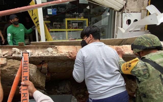 #Video Desplome de marquesina en local de Guadalajara deja una mujer lesionada - marquesina