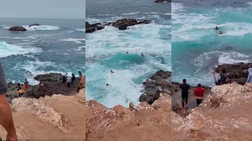 #Video Ola arrastra a turistas en Baja California que ignoraron advertencia - Ola arrastra al mar a turistas en La Bufadora, Baja California. Captura de pantalla