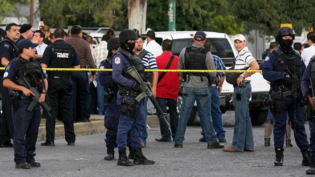 Dan 31 años de cárcel a asesinos de subdelegado de PGR en Guanajuato - Escena acordonada del asesinato en 2012 del subdelegado de la PGR en Guanajuato