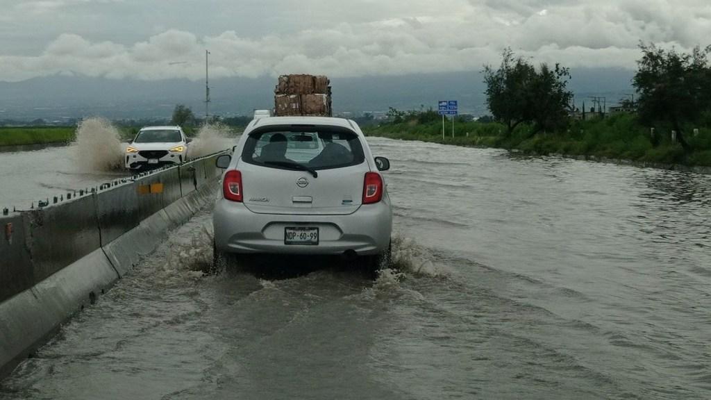 #Video Inundación afecta Circuito Exterior Mexiquense a la altura de Chimalhuacán - #Video Inundación afecta Circuito Exterior Mexiquense a la altura de Chimalhuacán. Foto de @edponce73