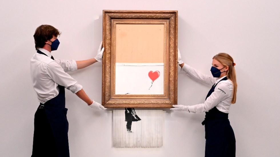 """""""Love is in the Bin"""" se vende por 25.4 mdd, un récord para Banksy - Love is in the Bin Banksy"""