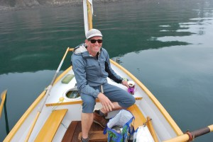 awkward Lord Sluggage posing for a picture while preparing coffee on a small boat at anchor