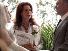 Lorelei Shellist, Ordained MInister, performing a wedding ceremony