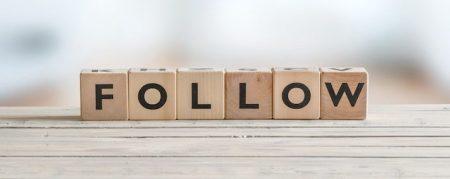 Follow sign on a wooden table - social media