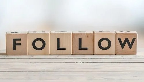 Follow sign on a wooden table - social media