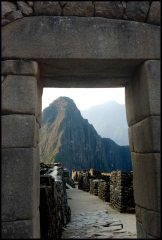 The main gate framing Huayna Picchu, directly inside are the storehouses of the Western sector.