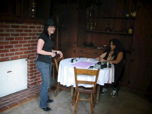 Sephera reading tarot with Diane of the GhostGirls. Photo by Nichole Boscia.