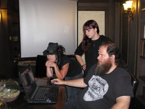 William cleans up EVP recordings on his computer while Diane and Kristin of the GhostGirls look on. Photo by Sephera Giron.